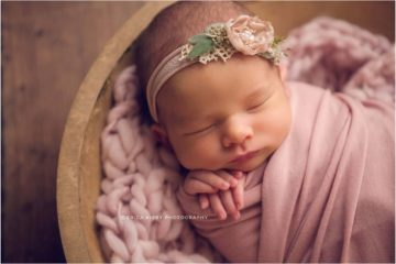 Newborn Photography Bentonville AR   Newborn Baby girl photography session in NWA with soft colors and floral accents   Erica Kirby Photography